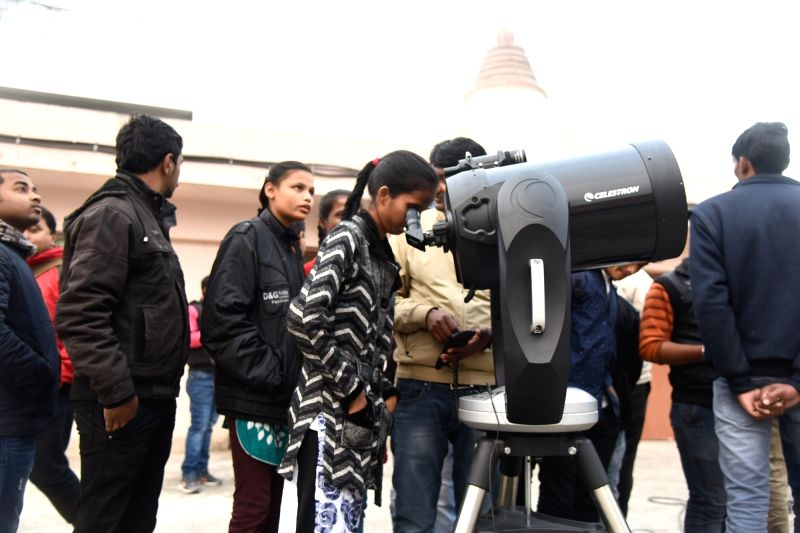 People witness lunar eclipse with telescope from Sri Krishan Science center in Patna on Jan 31, 2018.
