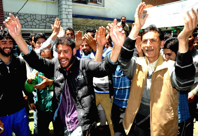 Peoples Democratic Party (PDP) workers celebrate victory of party chief Mehbooba Mufti Sayeed from Anantnag and party's overall performance in 2014 Lok Sabha Elections in Srinagar on May 16, 2014. - Mehbooba Mufti Sayeed