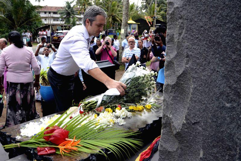 PERALIYA (SRI LANKA), Dec. 26, 2014 People commemorate victims of 2004 tsunami in Peraliya village, Sri Lanka, Dec. 26, 2014. Memorials and events were held in Sri Lanka Friday to ...