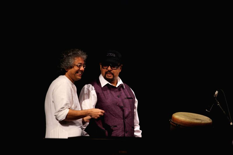 Percussionist Taufiq Qureshi and Musician, keyboardist and singer Louis Banks performs during the concert organised by Ustad Allarakha Institute of Music to mark the death anniversary of tabla ... - Ustad Allarakha Khan