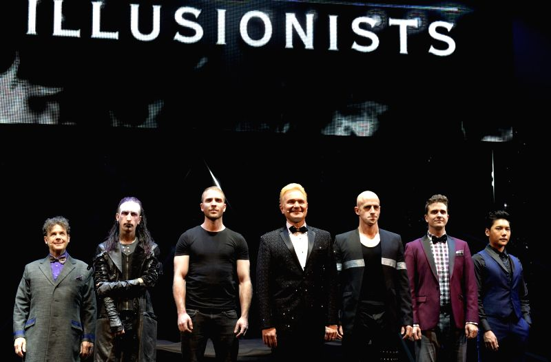 Performers of THE ILLUSIONISTS - LIVE ON BROADWAY attend a press conference at the Neil Simon Theatre in New York, the United States, Nov. 20, 2015. THE ...