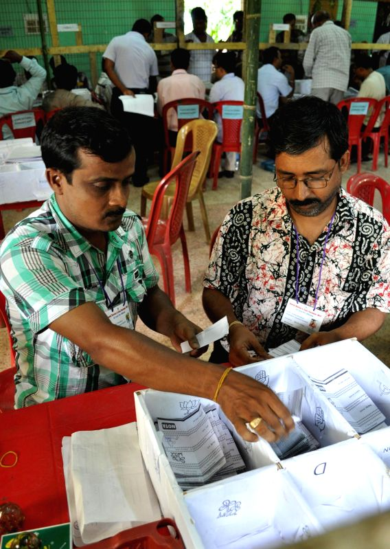 Personnel deployed on election duty busy counting ballots casted during recent local body elections at a counting centre in Dukli block of Tripura on July 18, 2014.