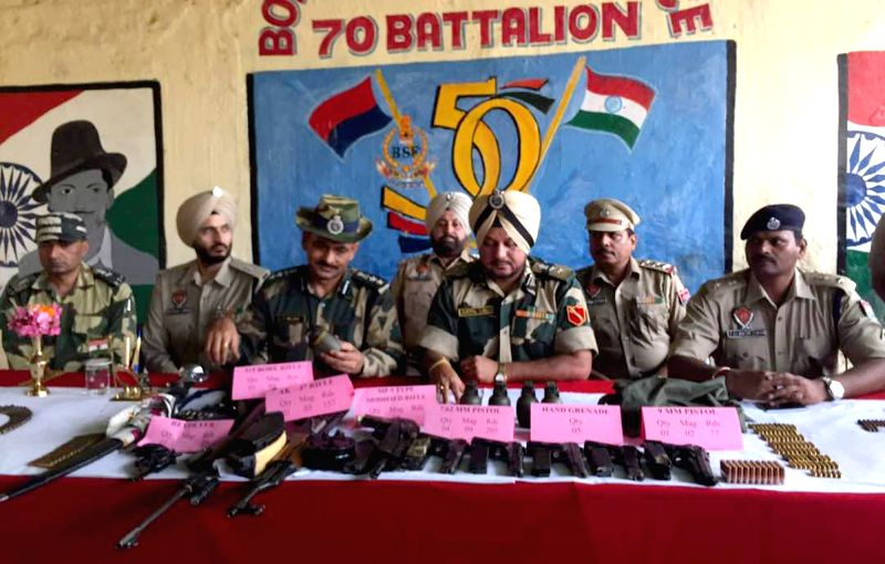 Personnel of BSF and Punjab Police present before press arms and ammunition recovered near Indo-Pak border in Amritsar on May 21, 2017.