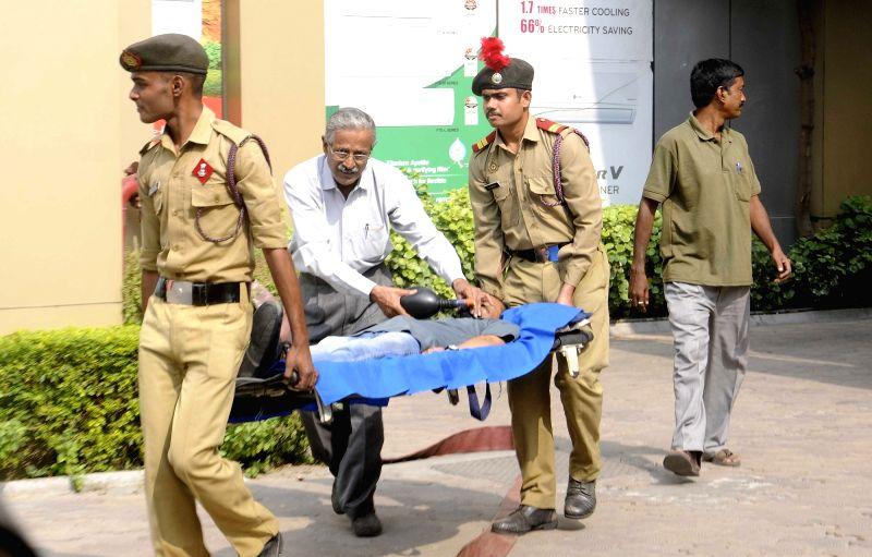 Personnel of Kolkata Police's Disaster Management Group (DMG) conduct mock drills in Kolkata, on Nov 19, 2015.