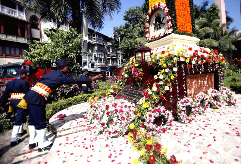Personnel of Mumbai fire brigade pay tribute to 66 firemen who sacrificed their lives in the great Bombay Dock explosion of 1944 on Fire Service Day at Byculla Fire Station in Mumbai on April 14, ...