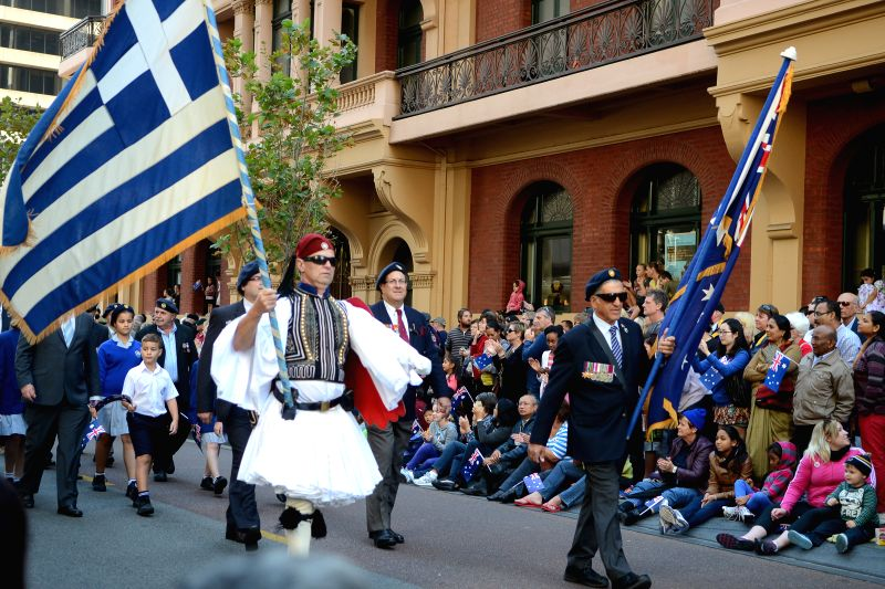 People take part in the ANZAC Day Parade in Perth, western Australia, April 25, 2014. Amid dark skies and the first taste of winter, thousands of ordinary ...