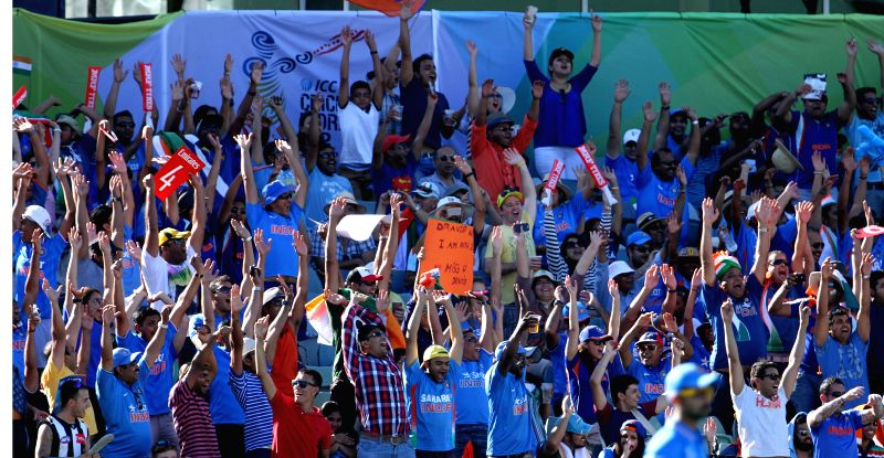 Cricket fans cheer during an ICC World Cup 2015 match between India and West Indies at Western Australia Cricket Association Ground, Perth, Australia on March 6, 2015.
