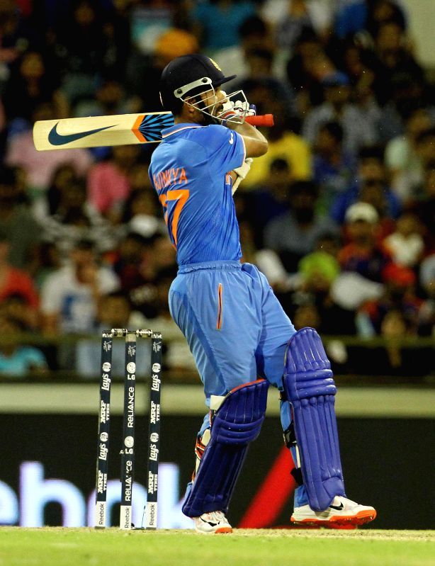 Indian batsman Ajinkya Rahane in action during an ICC World Cup 2015 match between India and West Indies at Western Australia Cricket Association Ground, Perth, Australia on March 6, 2015. - Ajinkya Rahane