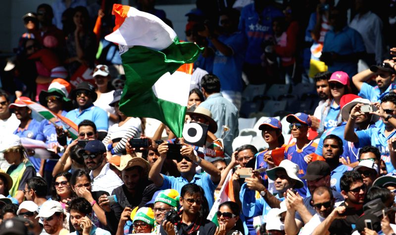 Indian fans cheer for their team during an ICC World Cup 2015 match between India and UAE at Western Australia Cricket Association Ground, Perth, Australia on Feb 28, 2015.