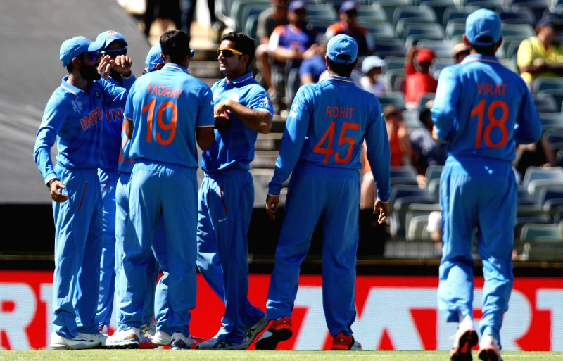 Indian players celebrate fall of a wicket during an ICC World Cup 2015 match between India and UAE at Western Australia Cricket Association Ground, Perth, Australia on Feb 28, 2015.