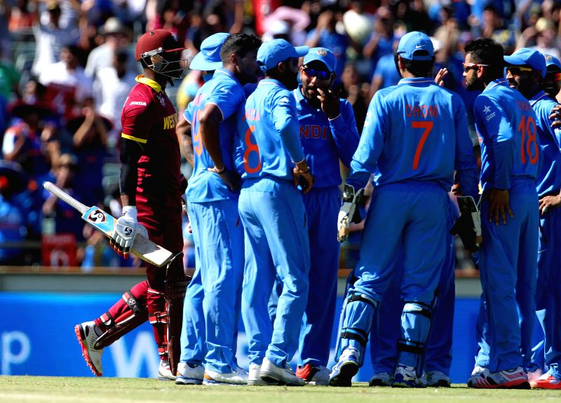 Indian players celebrate fall of a wicket during an ICC World Cup 2015 match between India and West Indies at Western Australia Cricket Association Ground, Perth, Australia on March 6, 2015.