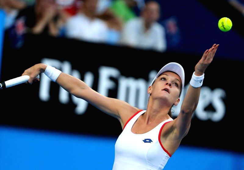 Agnieszka Radwanska of Poland serves to Australia's Casey Dellacqua during their second session women's singles match on day one of the Hopman Cup tennis tournament in