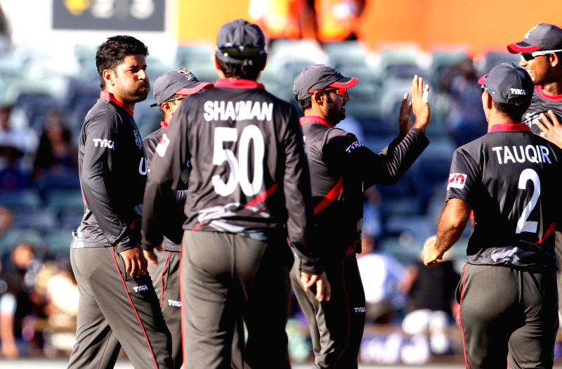UAE cricketers celebrate fall of a wicket during an ICC World Cup 2015 match between India and UAE at Western Australia Cricket Association Ground, Perth, Australia on Feb 28, 2015.