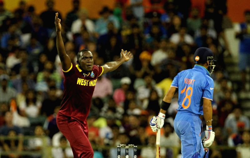 West Indian player Jerome Taylor and Indian batsman Virat Kohli during an ICC World Cup 2015 match between India and West Indies at Western Australia Cricket Association Ground, Perth, ... - Virat Kohli