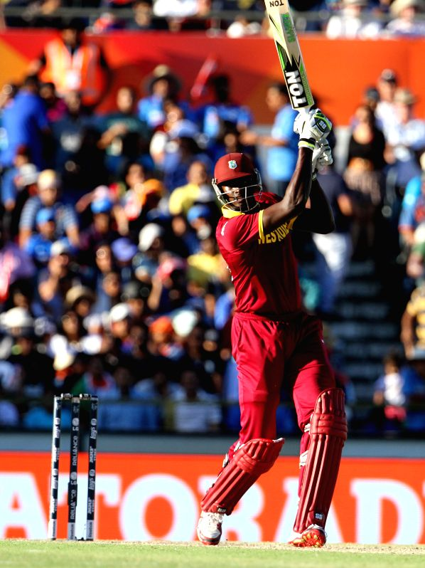 West Indies batsman Jason Holder in action during an ICC World Cup 2015 match between India and West Indies at Western Australia Cricket Association Ground, Perth, Australia on March 6, 2015. - Jason Holder