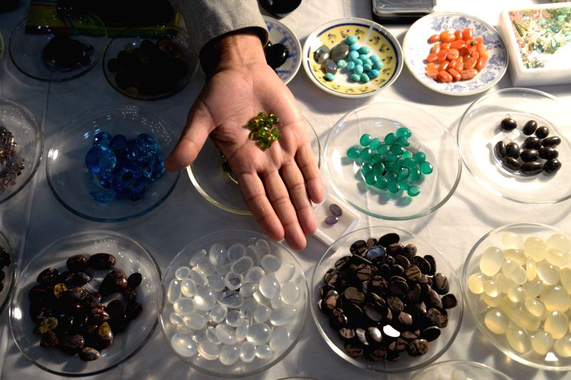 A vendor displays precious stones at Gems and Jewellery Exhibition in northwest Pakistan's Peshawar, Dec. 5, 2014. The three-day Gems and Jewellery Exhibition kicked off at Peshawar Museum .