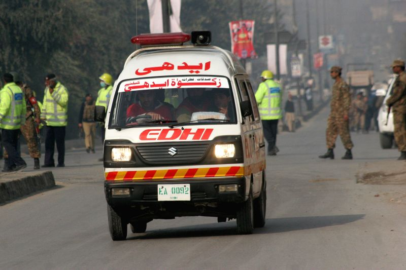 An ambulance rushes towards militants attack site in northwest Pakistan's Peshawar on Dec. 16, 2014. At least 14 people including 12 children were killed and over 30 others injured as a ...