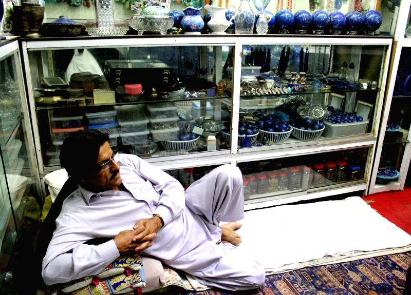 PESHAWAR, April 18, 2017 - A lapis lazuli shopkeeper waits for customers in northwest Pakistan's Peshawar on April 17, 2017.