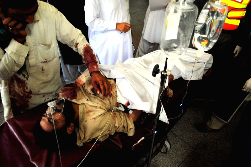 An injured man receives medical treatment at a hospital in northwest Pakistan's Peshawar on April 22, 2014. At least four people were killed and 33 others injured