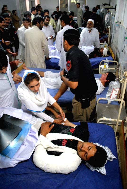 Injured policemen receive medical treatment at a hospital in northwest Pakistan's Peshawar, April 24, 2015. At least five policemen were injured when a bomb hit ...