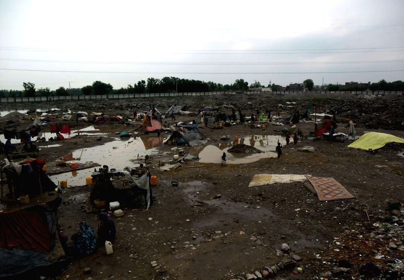 Photo taken on April 27, 2015 shows a view of a slum after heavy rain and storm in northwest Pakistan's Peshawar. At least 45 people have lost their lives and ...