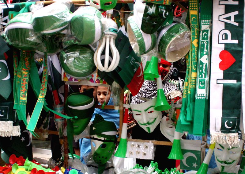 PESHAWAR, Aug. 10, 2016 - A Pakistani girl buys badges at a stall ahead of the country's Independence Day in northwest Pakistan's Peshawar, Aug. 10, 2016. Pakistan will celebrate its Independence Day ...