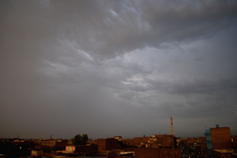 Dark clouds are seen over the sky of northwest Pakistan's Peshawar, Aug. 15, 2014. At least 13 people were killed and 55 others injured in two separate accidents ..