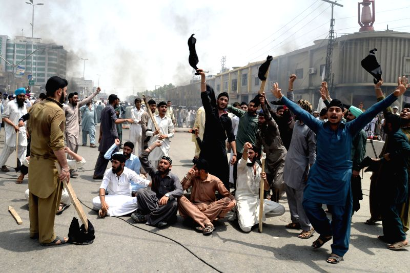 Pakistani Sikh minority shout slogans during a protest against the killing of a colleague in northwest Pakistan's Peshawar, on Aug. 6, 2014. A Sikh trader was shot .