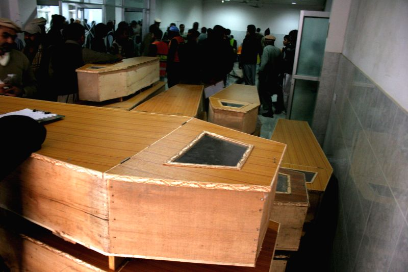 Coffins are seen at a hospital in northwest Pakistan's Peshawar on Dec. 16, 2014. The death toll of a terror attack on a school in Peshawar of Pakistan's northwest