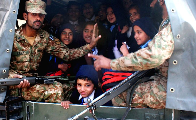 Pakistani soldiers transport rescued school children from the site of an attack by Taliban gunmen on a school in northwest Pakistan's Peshawar on Dec. 16, 2014. ...