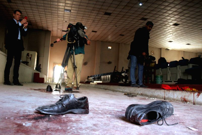 Journalists take footage of the main hall at an army-run school a day after an attack by Taliban militants in  northwest Pakistan's Peshawar on Dec. 17, 2014. At ..