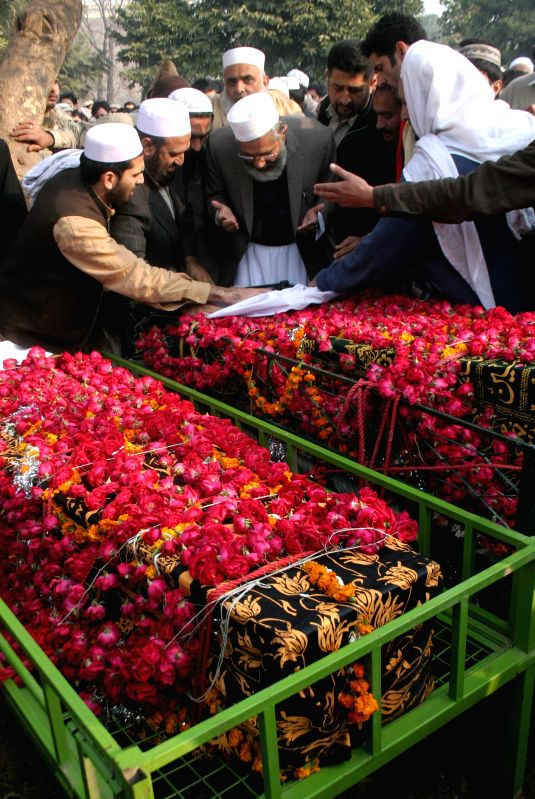 Pakistani mourners attend a funeral ceremony of victims of an attack by militants on an army-run school in northwest Pakistan's Peshawar on Dec. 17, 2014. A total .