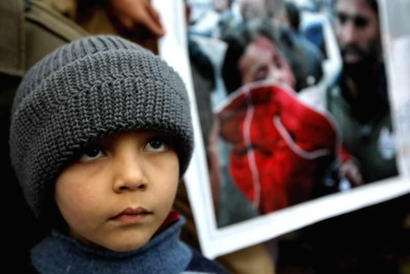A Pakistani child attends a protest to condemn Tuesday's Taliban attack on the Army Public School, in northwest Pakistan's Peshawar on Dec. 18, 2014. More then 140