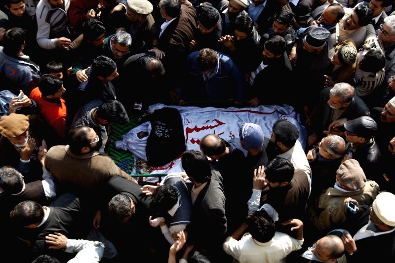 Pakistani Shiite Muslims attend a funeral ceremony of a suicide blast victim in northwest Pakistan's Peshawar, on Feb. 14, 2015. At least 19 people were killed and