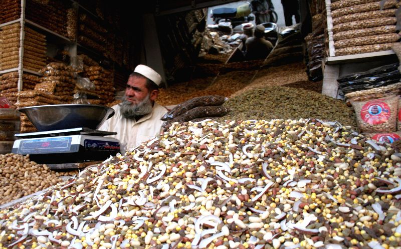 A Pakistani vendor waits for customers at a dry fruits shop in northwest Pakistan's Peshawar, Jan. 20, 2015. Demand of dry fruits increased in Pakistan during ...