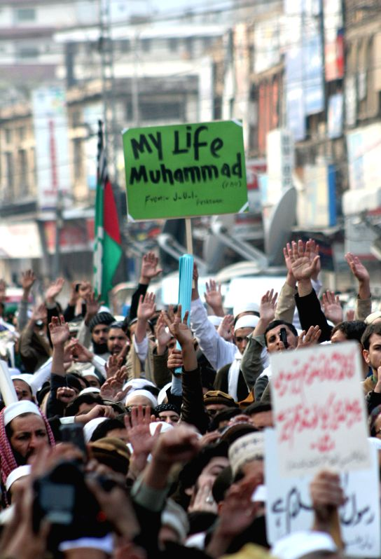 Supporters of Pakistani religious groups protest against the printing of caricature of Prophet Muhammad by French magazine Charlie Hebdo, in northwest Pakistan's ..
