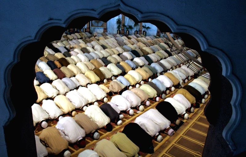 Pakistani Muslims offer prayers at a mosque during Lailat al-Qadr, also known as the Night of Power in northwest Pakistan's Peshawar on July 25, 2014. ...