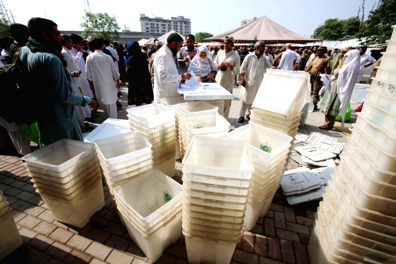 PESHAWAR, July 25, 2018 - Pakistani election officials gather to collect ballot boxes and other voting material at a distribution centre in northwest Pakistan's Peshawar on July 24, 2018. Pakistan ...