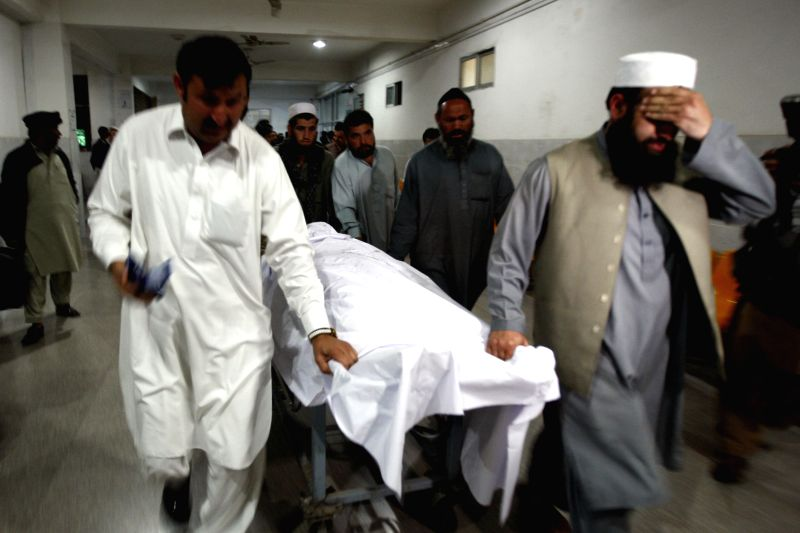 Rescuers transfer the body of Pakistani lawyer Samiullah Afridi after he was shot dead in northwest Pakistan's Peshawar on March 17, 2015. Gunmen in northwestern ...
