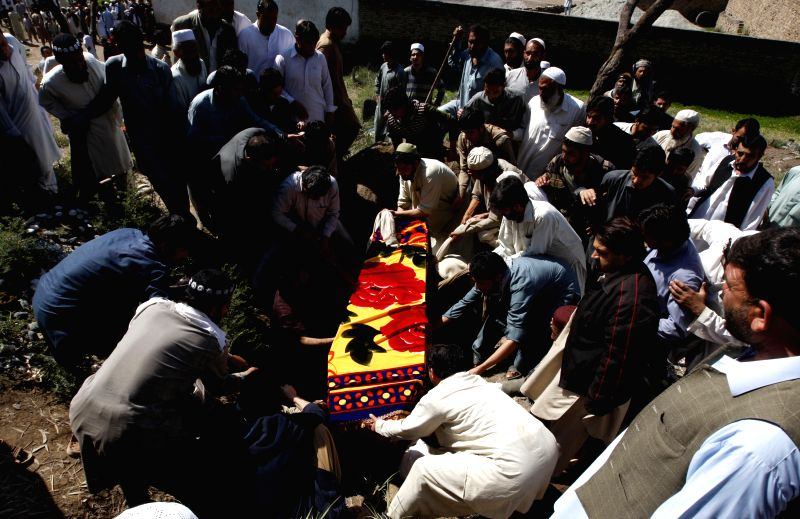 People attend the funeral of Pakistani lawyer Samiullah Afridi after he was shot dead in northwest Pakistan's Peshawar, March 18, 2015. Gunmen in northwestern ...