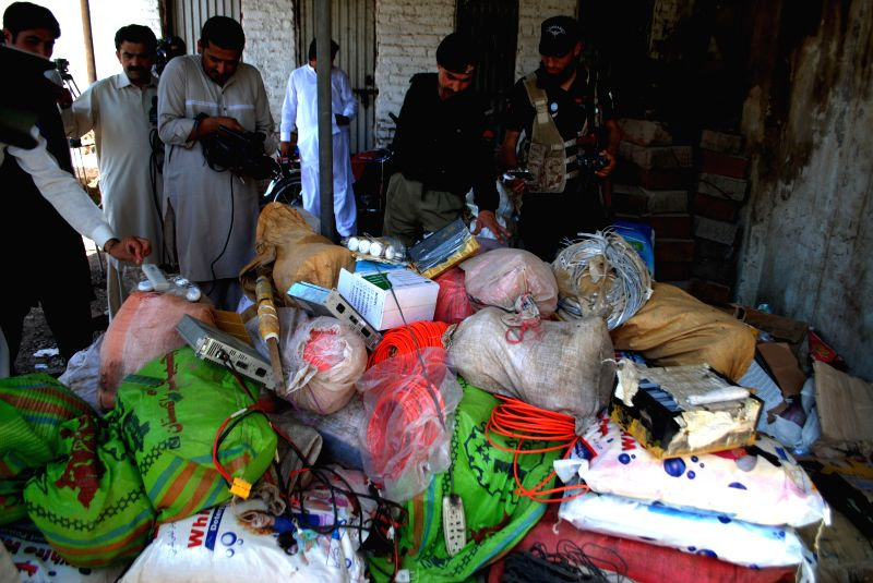 Policemen display seized explosive materials to media in northwest Pakistan's Peshawar, May 1, 2015. Police recovered 320 kilograms of explosives while foiling a ...