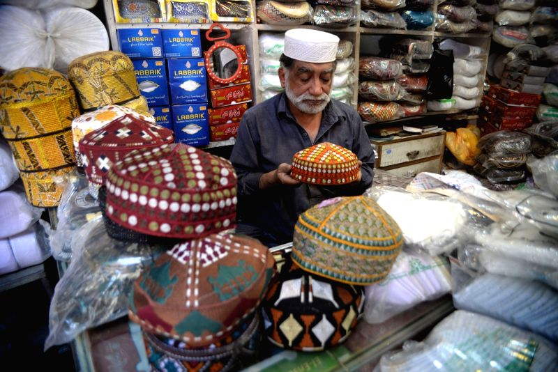 PESHAWAR, May 26, 2017 - A shopkeeper arranges traditional caps used to offer prayer ahead of the holy month of Ramadan in northwestern Pakistan's Peshawar, on May 26, 2017. Muslims are preparing for ...