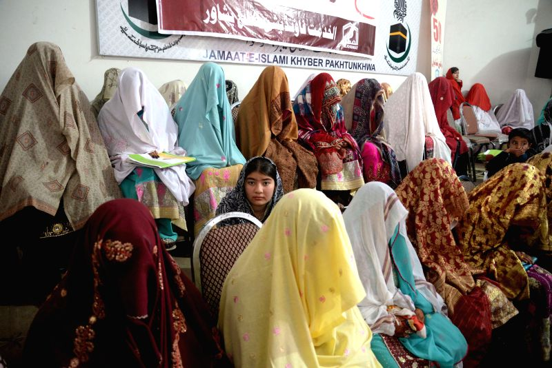 Peshawar (Pakistan): Pakistani brides sit during a mass wedding ceremony in northwest Pakistan's Peshawar, Nov. 29, 2014. A total of 50 couples participated in a group wedding ceremony organized by ..