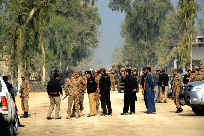 Peshawar (Pakistan): Pakistani soldiers cordon off a blast site in northwest Pakistan's Peshawar, Nov. 21, 2014. It is believed that at least one security officer was killed and six others sustained .