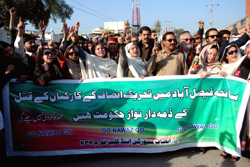 Peshawar :Pakistani activists from the opposition Pakistan Tehreek-e-Insaaf (PTI) shout slogans during a protest against the killing of a party worker in northwest Pakistan's Peshawar on Dec. 9, ...