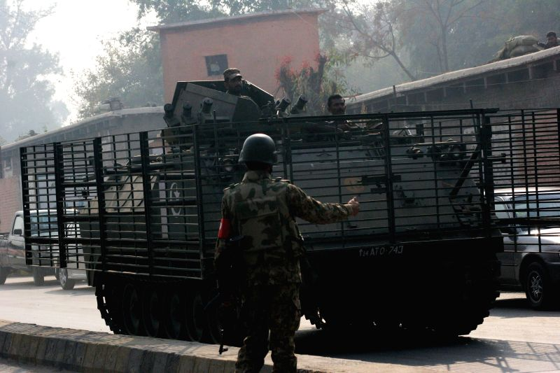 Pakistani army soldiers take part in an operation against militants near the attack site in northwest Pakistan's Peshawar on Dec. 16, 2014. At least 14 people including 12 children were ...