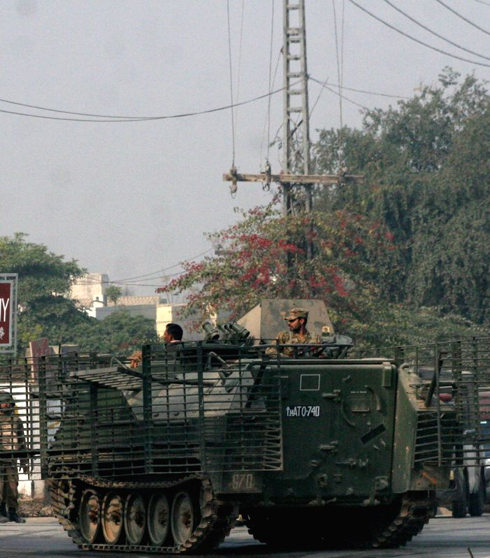 Pakistani army soldiers take part in an operation against militants near the attack site in northwest Pakistan's Peshawar on Dec. 16, 2014. At least 84 people including 81 students had been