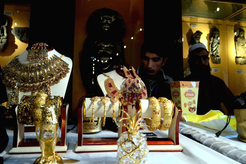 Vendors display jewellery at a stall at Gems and Jewellery Exhibition in northwest Pakistan's Peshawar, Dec. 5, 2014. The three-day Gems and Jewellery Exhibition kicked off at Peshawar ...