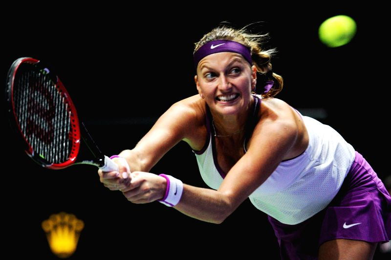 Petra Kvitova of the Czech Republic hits a return to her compatriot Lucie Safarova during the women's singles 3rd round match at the WTA finals tennis tournament ...