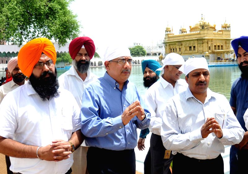 Petroleum secretary Saurabh Chandra (blue shirt) and  GAIL CMD BC Tripathi during their visit to the Golden Temple in Amritsar on July 9, 2014.